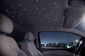 "Johnson Controls Automotive Experience: Innovative headliner features a ""Planetarium"" to go / Johnson Controls develops and supplies LED headliner, rear seat structure recliner and headrests for the Opel ADAM"