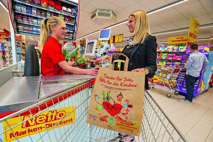 """Netto Marken-Discount ist Partner von """"RTL - Wir helfen Kindern"""" / Gewinnerbild des Netto-Kindermalwettbewerbs ist Motiv für  Spendentaschen"""