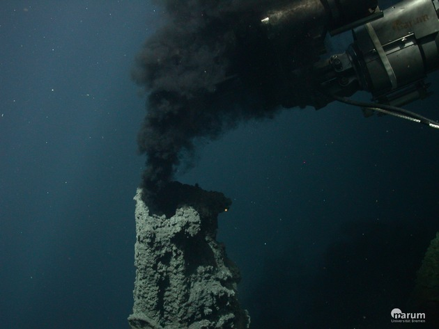 "The underwater robot ROV Quest takes water samples at a so-called ""black smoker"" on the seabed. Photo: MARUM"
