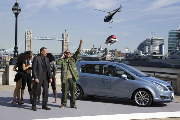 "Energetic Corsa world premiere reveal in London with hot entertainment: Opel took to the air tonight as the all-new Corsa was escorted to the scene at Old Billingsgate, London, by a helicopter flying over the river Thames. On the outdoor stage: Alain Visser (left), Executive Director, European Marketing for Opel, and Grammy-award winning reggae hip-hop superstar, Sean Paul, the entertainment for the special premiere event, with the all-new Corsa. Seven hundred fans were invited for a private VIP concert inside Old Billingsgate immediately following the spectacular reveal. Editorial use of this picture is free of charge. Please quote the source: ""ops/Adam Opel GmbH"""