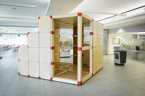 Architekturstudierende und Tischlerlehrlinge entwerfen ihren Arbeitsplatz der Zukunft