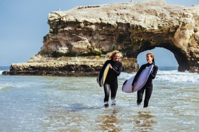 Surfer Natural Bridges State Park_(C)Visit Santa Cruz County