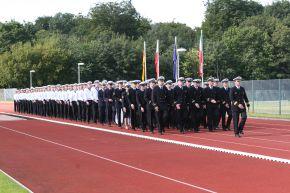 Einmarsch der Truppenfahne. Foto: Deutsche Marine.
