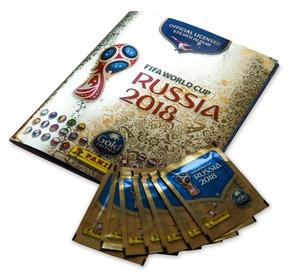 """Album y pochettes 2 / Panini 2018 FIFA World Cup RussiaTM - Gold Edition / Texte complémentaire par ots et sur www.presseportal.ch/fr/nr/100020842 / L'utilisation de cette image est pour des buts redactionnels gratuite. Publication sous indication de source: """"obs/PANINI SUISSE AG"""""""