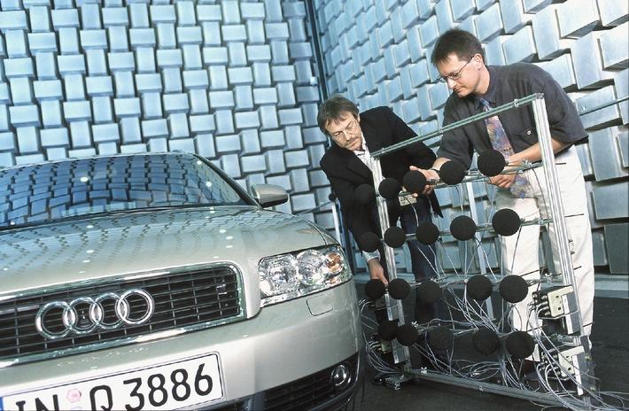 """Geräuschanalyse bei Audi in einem schallgedämmten Akustik-Prüfstand: Eckhard Peithmann (links) und Carsten Vortanz (rechts) vom Knister-Knaster-Team justieren Mikrofone an einem Audi A4 Avant. Das Team ist störenden Geräuschen im Fahrzeug auf der Spur. /Creaking and Cracking Team.Noise analysis in a soundproofed acoustic test rig at Audi: Eckhard Peithmann (left) and Carsten Vortanz (right) from the 'Creaking and Cracking Team' are adjusting dummy-head microphones in an Audi A4 Avant. The team is tracking down the irritating noises that can occur inside a car. Die Verwendung dieses Bildes ist für redaktionelle Zwecke honorarfrei. Abdruck bitte unter Quellenangabe: """"obs/Audi""""."""